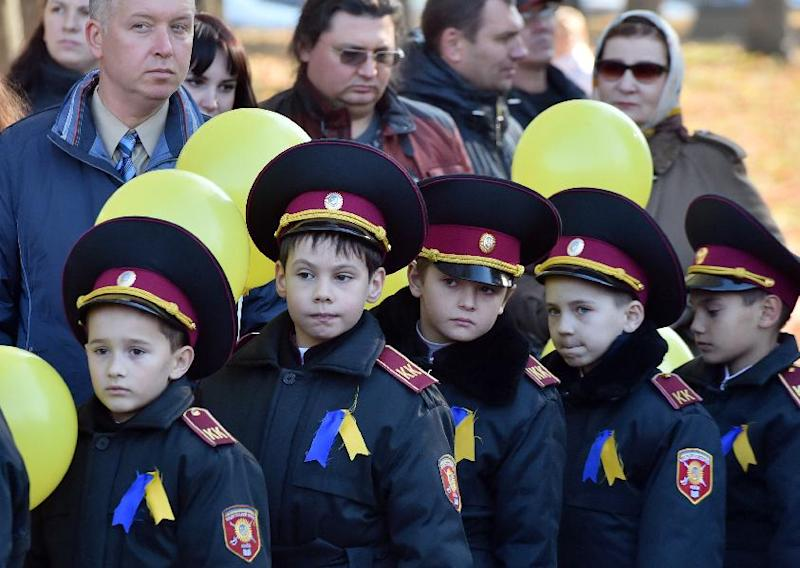 Boys in the Ukrainian Cadets Corps attend a memorial ceremony in Kiev on October 28, 2014 marking the 70th anniversary of the liberation of Ukraine from Nazi occupation during WWII (AFP Photo/Sergei Supinsky)
