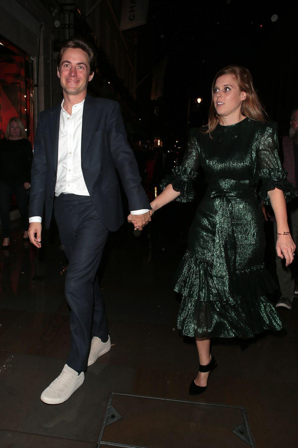 <p>Another shot of the couple shows Edo smiling after the book launch afterparty. </p>