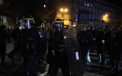 <span>CRS riot police stand as protestors gather in front of the Bouffes du Nord theatre in Paris on where the French President attended a play</span> <span>Credit: LUCAS BARIOULET/AFP </span>