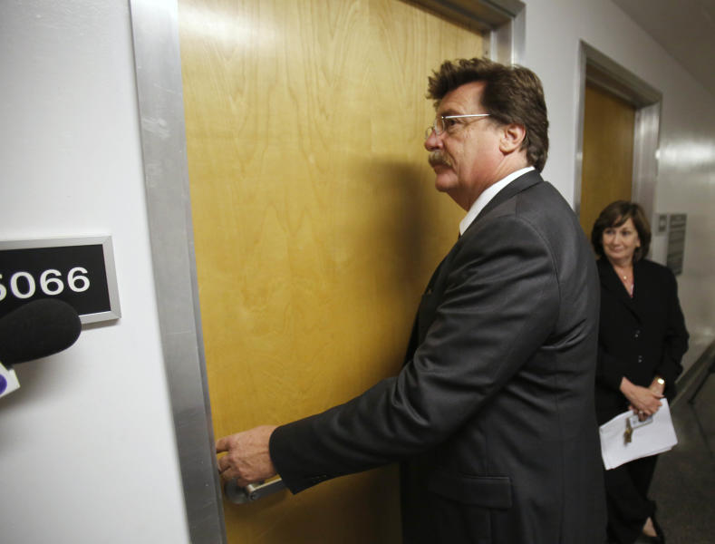 Attorney Bill Portanova waits to be let into the office of state Sen. Ron Calderon, D-Montebello, that was being searched by the FBI at the Capitol in Sacramento, Calif., Tuesday, June 4, 2013. The FBI did not disclose the reason for the search warrants that were served on Calderon and on the office of the Legislature's Latino caucus. Calderon was not present during the search.(AP Photo/Rich Pedroncelli)