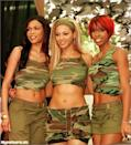 """<p>Back in the day, Beyoncé and her Destiny's Child bandmates wore coordinating outfits for performances, red carpet appearances, and in music videos. They often picked a theme, like the camouflage ensembles they wore for the """"Survivor"""" music video and subsequent album signings. These camouflage print outfits sent the obvious message that these ladies were prepared to take on anything.</p>"""