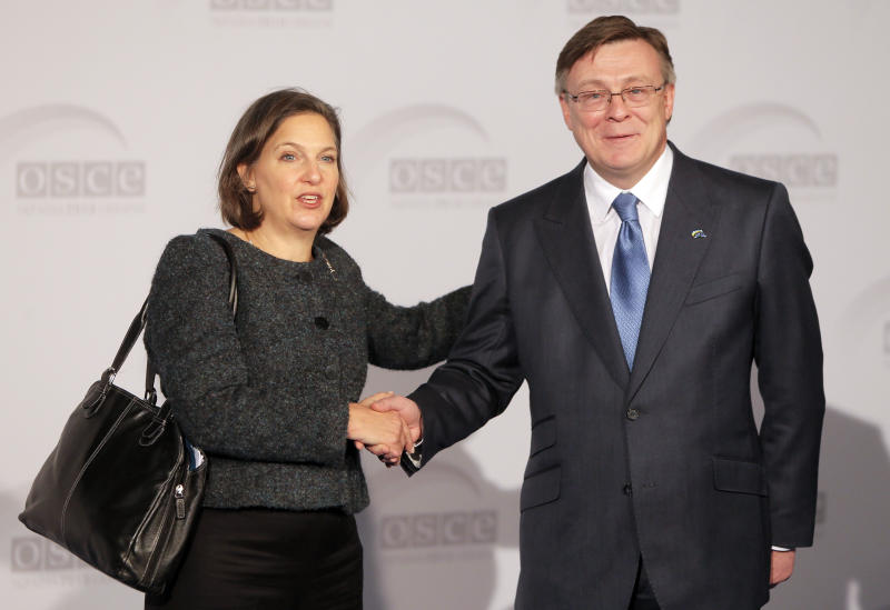 U.S. Assistant Secretary for European and Eurasian Affairs Victoria Nuland, left, shakes hands with Ukrainian Minister of Foreign Affairs Leonid Kozhara during the 20th Organization for Security and Cooperation in Europe Ministerial Council Summit in Kiev, Ukraine, Thursday, Dec. 5, 2013. Foreign diplomats have converged on a tense Ukrainian capital, which is gripped by massive protests against the government's decision to freeze ties with the EU and turn to Moscow instead. (AP Photo/Efrem Lukatsky)