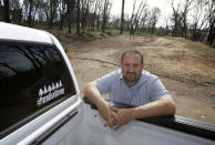 In this Thursday, Oct. 24, 2019, photo, Paradise City Councilman Michael Zuccolillo poses at the lot where his home once stood before it was destroyed by last year's Camp Fire in Paradise, Calif. Zuccolillo's home is one of nearly 9,000 Paradise homes destroyed in the deadliest and most destructive wildfire in California history. (AP Photo/Rich Pedroncelli)