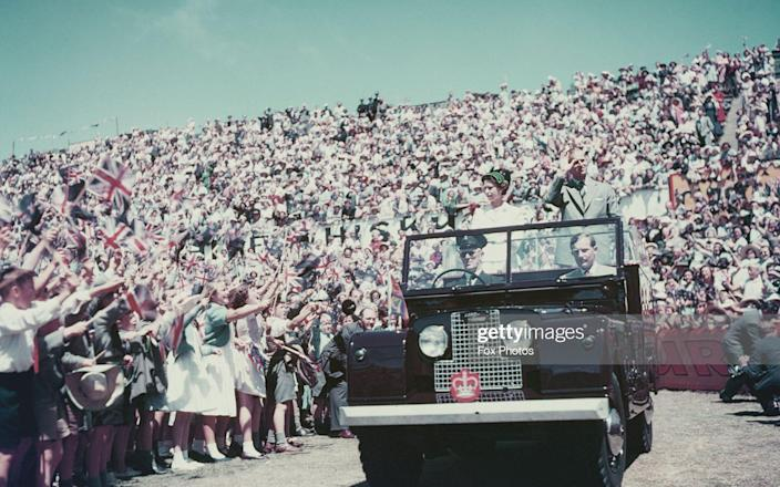 Queen Elizabeth II and Prince Philip wave to the crowd whilst on their Commonwealth visit to Australia, 1954 - Fox Photos/2013 Getty Images