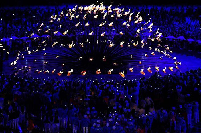 """<p>The sculptural <a href=""""http://www.heatherwick.com/olympic-cauldron/"""" rel=""""nofollow noopener"""" target=""""_blank"""" data-ylk=""""slk:Olympic cauldron featured 204 torches"""" class=""""link rapid-noclick-resp"""">Olympic cauldron featured 204 torches</a>, each representing a national team competing in the games, that moved to come together to symbolize unity. </p>"""