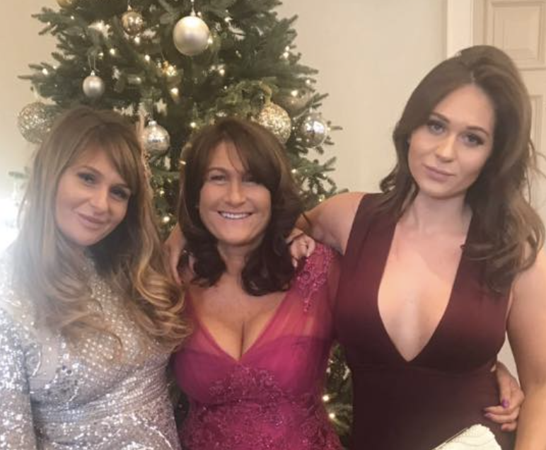 Denise (middle), pictured with two of her daughters, suffered the menopause aged 32. [Photo: Denise Harding]