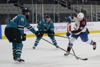 Colorado Avalanche left wing Andre Burakovsky, right, shoots the winning goal against San Jose Sharks defenseman Brent Burns (88) and center Logan Couture (39) during overtime of an NHL hockey game in San Jose, Calif., Monday, May 3, 2021. The Avalanche won, 5-4. (AP Photo/Jeff Chiu)