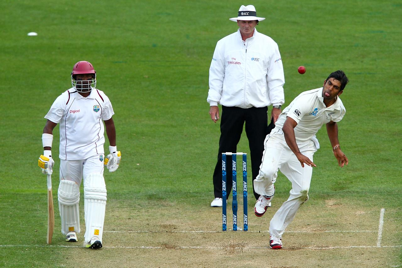WELLINGTON, NEW ZEALAND - DECEMBER 12:  Ish Sodhi of New Zealand bowls while Narsingh Deonarine of the West Indies looks on during day two of the Second Test match between New Zealand and the West Indies at Basin Reserve on December 12, 2013 in Wellington, New Zealand.  (Photo by Hagen Hopkins/Getty Images)