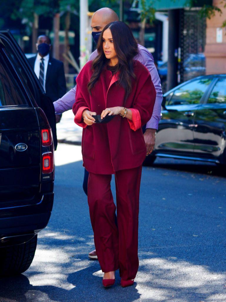<p>For a visit to a school in Harlem during her and husband Prince Harry's trip to New York the Duchess of Sussex stepped into and effortlessly chic maroon two-piece by Loro Piana. Featuring a 1980</p>