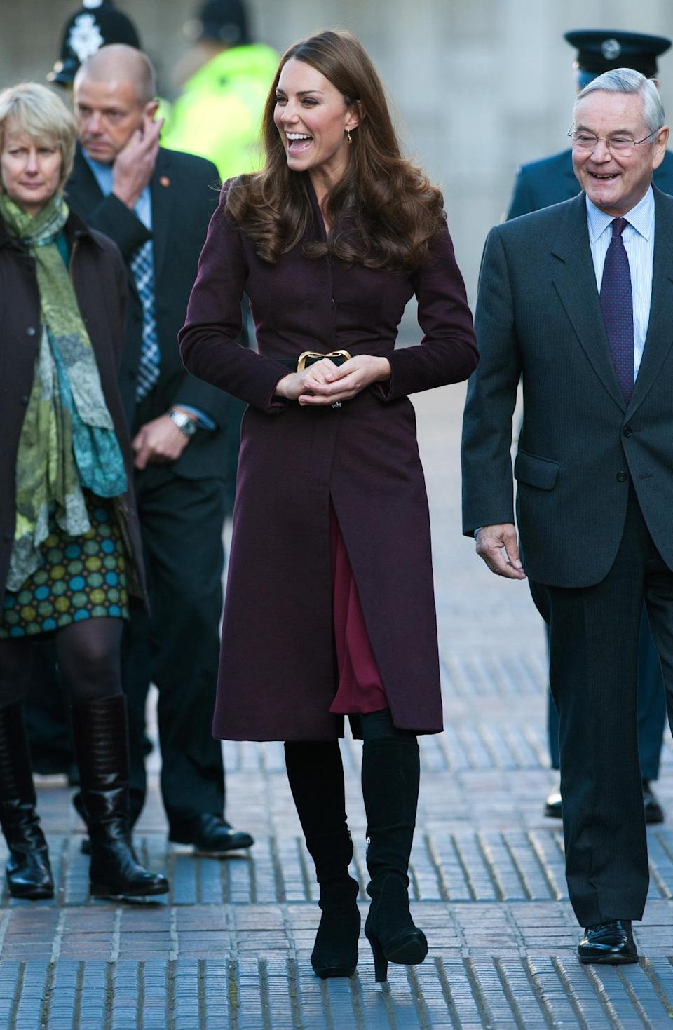 <p>Kate took a solo trip to Newcastle in an aubergine coat (with a red Whistles dress underneath) complemented by her trusty Aquatalia boots. </p><p><i>[Photo: PA]</i></p>