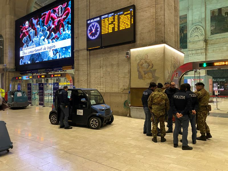 Military and policemen are seen inside Milan's main train station as Italian authorities prepare to lock down Lombardy to prevent the spread of the highly infectious coronavirus in Milan,