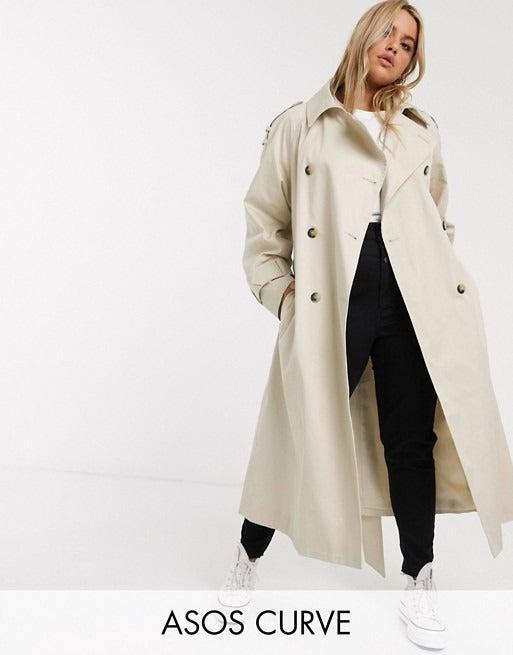 """<br><br><strong>ASOS DESIGN Curve</strong> Longline Trench Coat In Stone, $, available at <a href=""""https://www.asos.com/asos-curve/asos-design-curve-longline-trench-coat-in-stone/prd/13544023?"""" rel=""""nofollow noopener"""" target=""""_blank"""" data-ylk=""""slk:ASOS"""" class=""""link rapid-noclick-resp"""">ASOS</a>"""