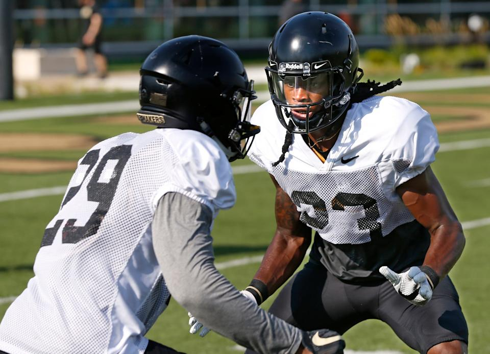 Cornerback Cory Trice, right, lines up opposite fellow cornerback Simeon Smiley during football practice Monday, August 6, 2018, at Purdue.