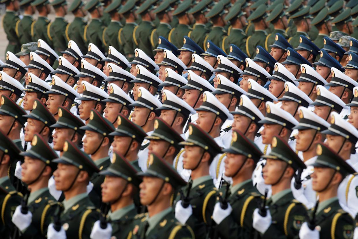 Soldiers of People's Liberation Army (PLA) stand in formation near Tiananmen Square before a military parade marking the 70th founding anniversary of People's Republic of China, on its National Day in Beijing, China October 1, 2019. (Photo: Jason Lee/Reuters)