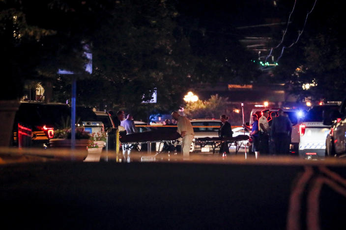 Bodies are removed from at the scene of a mass shooting, Sunday, Aug. 4, 2019, in Dayton, Ohio. Several people in Ohio have been killed in the second mass shooting in the U.S. in less than 24 hours, and the suspected shooter is also deceased, police said. (Photo: John Minchillo/AP)