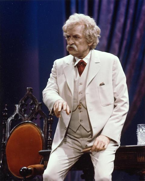 """This image provided by Hal Holbrook shows Holbrook performing his one-man show """"Mark Twain Tonight."""" Holbrook is in the midst of a marathon of theater. 2014 marks the 60th consecutive year of his one-man show relating the satire and social commentary that he began delivering during the civil rights era to audiences today. Ahead of the 89-year-old actor's stop at the National Theatre in Washington, Holbrook explains why Twain remains relevant as Holbrook adds material on the Bible, the labor movement and a section of """"Huckleberry Finn."""" (AP Photo/Courtesy of Hal Holbrook)"""