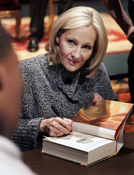 """FILE This Thursday, Oct. 18, 2007 file photo shows author J. K. Rowling signing a copy of her book """"Harry Potter and the Deathly Hallows"""" in New Orleans. At last, Harry Potter's adventures are available electronically. The seven novels about J.K. Rowling's boy wizard are for sale as e-books and audio books on the author's Pottermore website, the site's creators announced Tuesday March 27, 2012. The books are available only through the website, which says they are compatible with major electronic e-readers, including Amazon's Kindle and Sony's Reader, as well as with tablets and mobile phones. (AP Photo/Bill Haber,File)"""