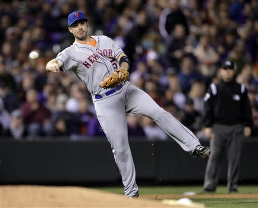 New York Mets third baseman David Wright fields a ground ball hit by Colorado Rockies' Ramon Hernandez and throws out Hernandez at first in the fourth inning of their baseball game in Denver on Friday, April 27, 2012. (AP Photo/Joe Mahoney)