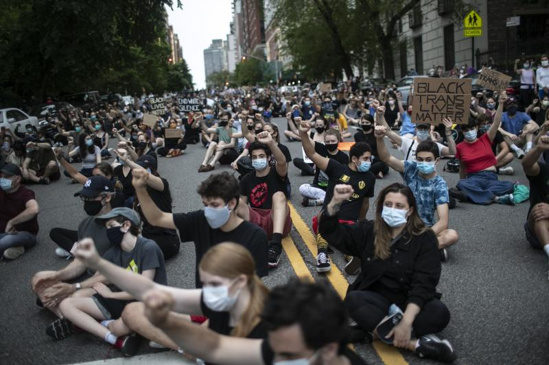 Protesters sit together with their fists in the air during a solidarity rally calling for justice over the death of George Floyd, Wednesday, June 3, 2020, in New York. Floyd died in police custody in Minneapolis on May 25. (AP Photo/Wong Maye-E)