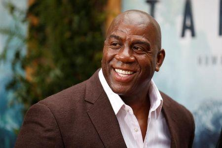 """Former NBA basketball player Earvin Magic Johnson poses at the premiere of the movie """"The Legend of Tarzan"""" in Hollywood, California, June 27, 2016. REUTERS/Danny Moloshok"""
