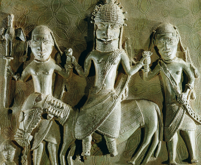 A Benin brass plaque from the palace, depicting an oba on horseback supported by two retainers in the British Museum collection