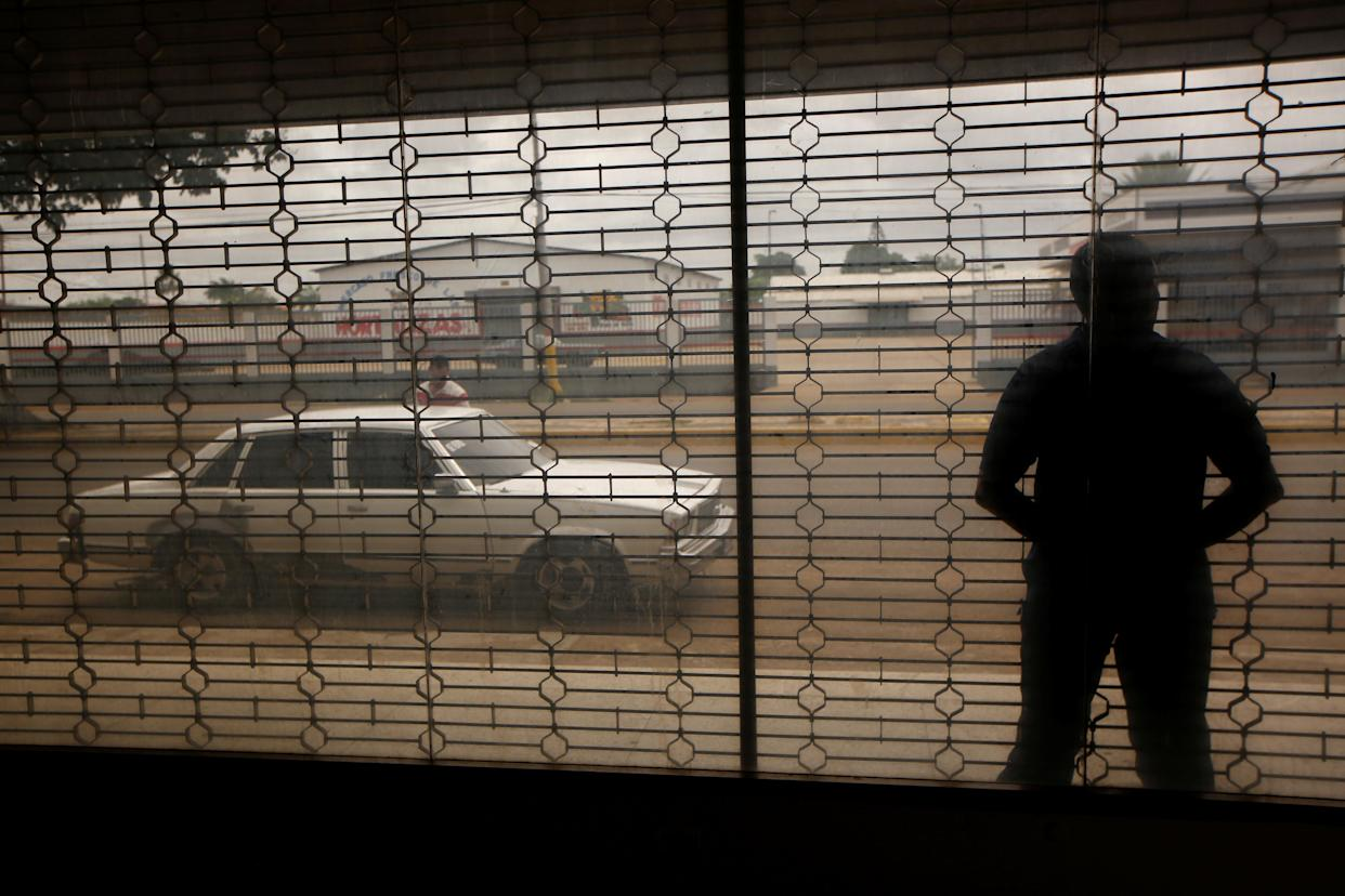 A taxi driver waits for customers in El Tigre, Venezuela, on June 4. (Photo: Ivan Alvarado/Reuters)