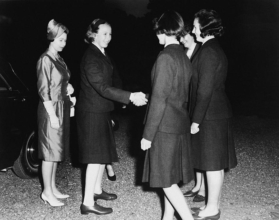 <p>Arriving to her first day at Benenden College with her mother, Queen Elizabeth. The young Princess started her education at the all-girls boarding school in Kent, England in 1963. </p>