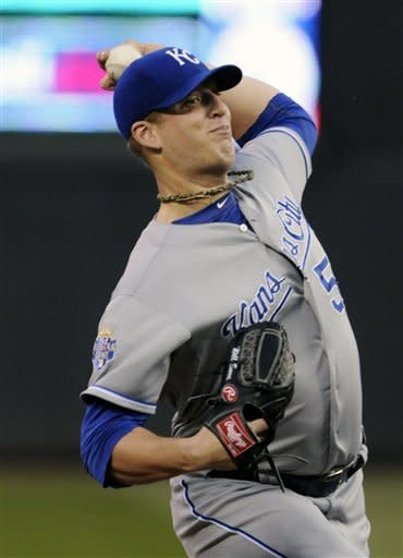 Kansas City Royals pitcher Will Smith throws against the Minnesota Twins in the first inning of a baseball game, Tuesday, Sept. 11, 2012, in Minneapolis. (AP Photo/Jim Mone)