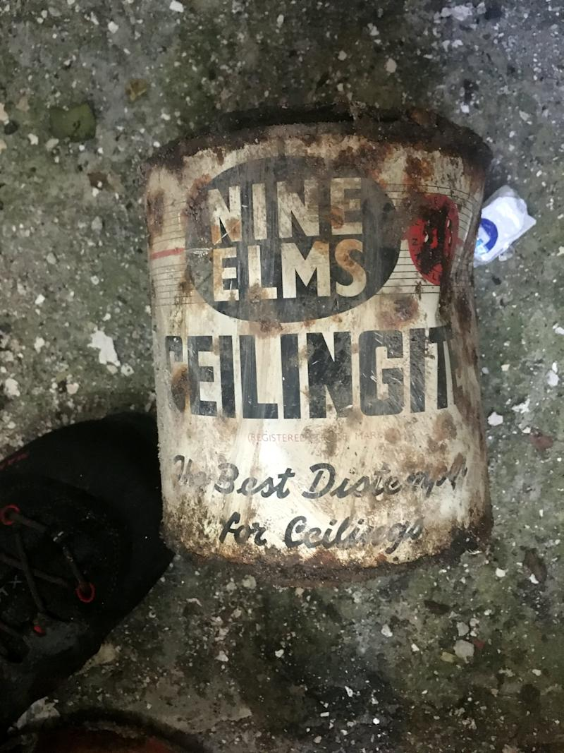 A can found behind the wall in Jake Brown's home in Plymouth, Devon (SWNS)