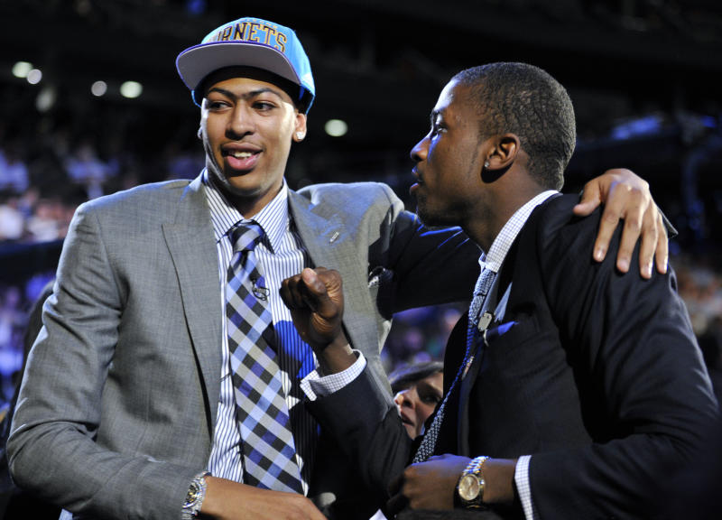 FILE - In this June 28, 2012, file photo, Kentucky's Anthony Davis, left, is congratulated by former teammate Michael Kidd-Gilchrist, right, after Davis was selected as the No. 1 overall draft pick by the New Orleans Hornets at the NBA basketball draft in Newark, N.J. With no Final Four on tap this weekend thanks to the coronavirus, we instead put together a list of the greatest one-and-done players ever. Davis and Syracuses Carmelo Anthony top our list after leading their teams to national titles their lone season in college. (AP Photo/Bill Kostroun, File)