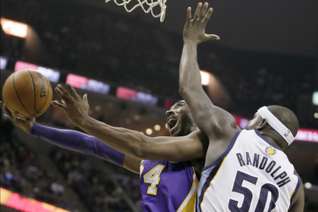 Los Angeles Lakers' Kobe Bryant goes to the basket in front of Memphis Grizzlies' Zach Randolph (50) during the first half of an NBA basketball game in Memphis, Tenn., Tuesday, Dec. 17, 2013. (AP Photo/Danny Johnston)