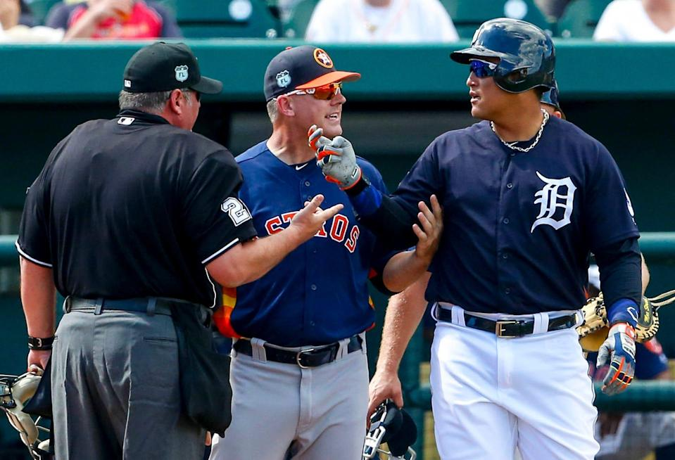 Tigers' Miguel Cabrera reacts with Astros manager A.J. Hinch and umpire Hunter Wendelstedt, after Cabrera was hit by a pitch in the third inning during a spring training game at Joker Marchant Stadium, Feb. 25, 2017 in Lakeland, Fla.