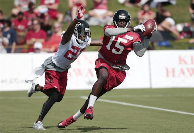 Atlanta Falcons wide receiver Geraldo Boldewijn (15) makes a catch in front of cornerback Robert Alford (23) during an NFL football training camp Friday, July 25, 2014, in Flowery Branch, Ga. (AP Photo)