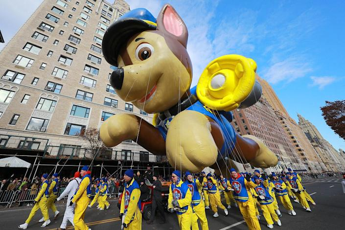 Nickelodeon's Paw Patrol's Chase balloon strolls down Central Park West during the 93rd Macy's Thanksgiving Day Parade in New York. Chase's cap could cover an actual police squad car. (Photo: Gordon Donovan/Yahoo News)