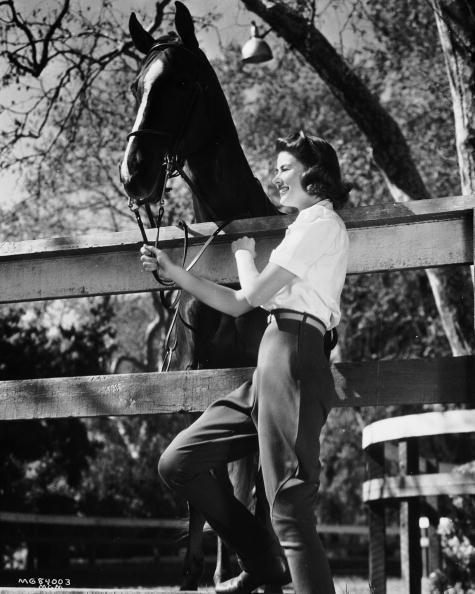 """<p>Ingrid Bergman certainly looks the part of an equestrian in her riding pants as she visits her horse in California. The Swedish actress's skills on horseback came in handy when she starred in <em><a href=""""https://www.imdb.com/title/tt0040491/"""" rel=""""nofollow noopener"""" target=""""_blank"""" data-ylk=""""slk:Joan of Arc"""" class=""""link rapid-noclick-resp"""">Joan of Arc </a></em><a href=""""https://www.imdb.com/title/tt0040491/"""" rel=""""nofollow noopener"""" target=""""_blank"""" data-ylk=""""slk:in 1948"""" class=""""link rapid-noclick-resp"""">in 1948</a>.  </p>"""