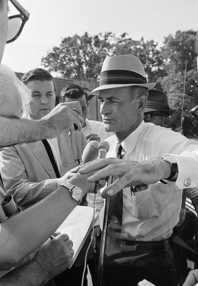 <p>Miss. Gov. Paul Johnson faces reporters in Philadelphia, Miss., on Friday, afternoon, June 27, 1964 after his arrival. He was in town to receive a briefing on search progress for three missing integrationists whose burned out station wagon was discovered Tuesday near Philadelphia. Gov. Johnson later visited the spot where the burned vehicle was found. A search is still underway for the missing trio. (Photo: JAB/AP) </p>