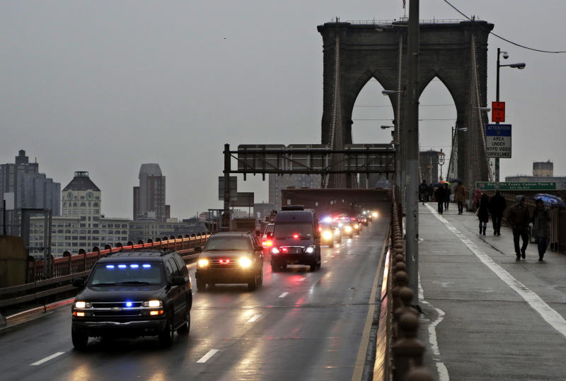 """A caravan of police vehicles shuttles Mexican drug kingpin Joaquin """"El Chapo"""" Guzman across the Brooklyn Bridge from a court appearance in Brooklyn to a Manhattan jail facility, Friday, Jan. 20, 2017, in New York. Guzman was extradited Thursday from Mexico. Prosecutors have sought to bring him to a U.S. court for years while he made brazen prison escapes and spent years on the run in Mexico. (AP Photo/Mark Lennihan)"""