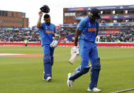A frustrated Kohli and Shankar walk off as rain stops play (Photo by Martin Rickett/PA Images via Getty Images)