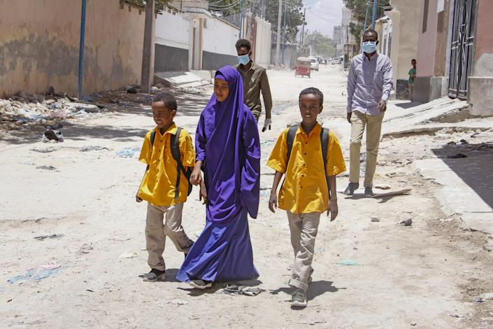"""Children walk home in Mogadishu, Somalia, in March after the government announced the closure of schools due to the COVID-19 outbreak. <span class=""""copyright"""">(Farah Abdi Warsameh / Associated Press)</span>"""