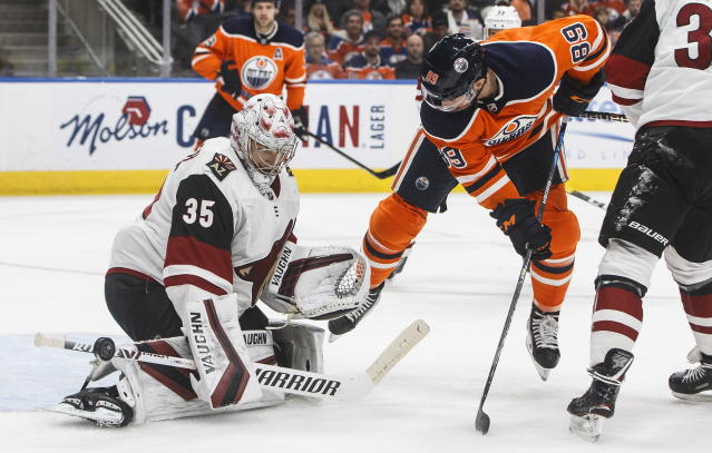 Arizona Coyotes ' goalie Darcy Kuemper (35) makes a save against Edmonton Oilers' Sam Gagner (89) during second-period NHL hockey game action in Edmonton, Alberta, Monday, Nov. 4, 2019. (Jason Franson/The Canadian Press via AP)