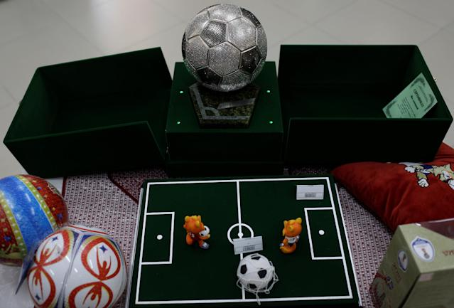 A luxury soccer ball decorated with Swarovski stones is pictured for sale at a souvenir store in Saransk, Russia June 20, 2018. Picture taken June 20, 2018. REUTERS/Ricardo Moraes