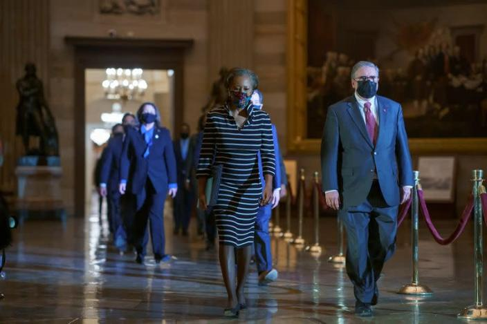 Clerk of House Cheryl Johnson along with House Sergeant-at-Arms Tim Blodgett walk through Statuary Hall to deliver to Senate article of impeachment alleging incitement of insurrection against former President Trump