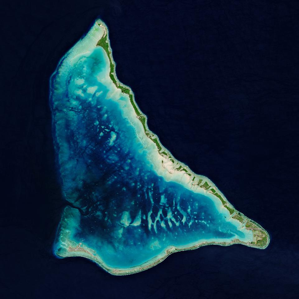 The Tarawa Atoll, a remote Pacific nation in the Republic of Kiribati, can be seen from space in this image captured by the Copernicus Sentinel-2 mission.  Kiribati is an independent island nation spreading out 1351357 square miles (3.5 million square kilometers) of the ocean with a total land area of just 309 sq miles (800 sq km).