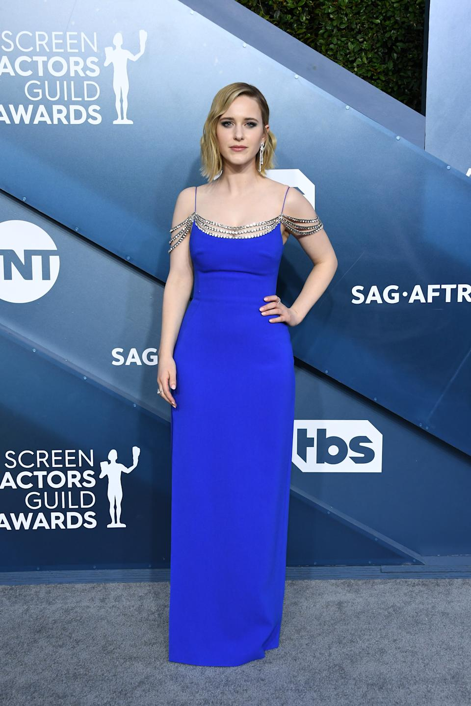 """""""The Marvelous Mrs. Maisel"""" star traded in her character's retro wardrobe in favour of a cobalt blue Stella McCartney gown with chainlink detailing."""