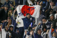 New York Yankees fans cheer starting pitcher Masahiro Tanaka at the start of Game 4 of baseball's American League Championship Series against the Houston Astros, Thursday, Oct. 17, 2019, in New York. (AP Photo/Seth Wenig)