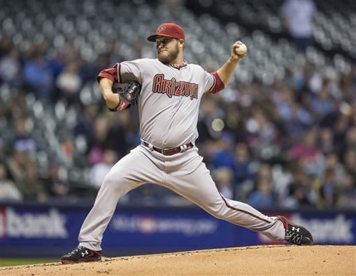 Arizona Diamondbacks' Wade Miley pitches to a Milwaukee Brewers' batter during the first inning of a baseball game Friday, April 5, 2013, in Milwaukee. (AP Photo/Tom Lynn)