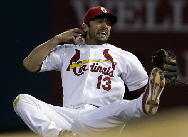 St. Louis Cardinals second baseman Matt Carpenter loses control of the ball while falling giving Milwaukee Brewers' Scooter Gennett enough time to reach first for a single during the first inning of a baseball game, Thursday, Sept. 12, 2013, in St. Louis. (AP Photo/Jeff Roberson)
