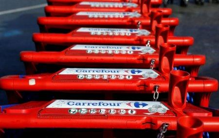 FILE PHOTO: The logo of Carrefour is seen on shopping trolleys at the Carrefour Lingostiere in Nice, France, March 31, 2018. REUTERS/Eric Gaillard/File Photo