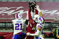 FILE - Arizona Cardinals wide receiver DeAndre Hopkins (10) pulls in the game winning touchdown pass as Buffalo Bills free safety Jordan Poyer (21) and strong safety Micah Hyde (23) defend during the second half of an NFL football game in Glendale, Ariz., in this Sunday, Nov. 15, 2020, file photo. Hopkins was the highlight of a deal costing Arizona only two draft picks, nothing higher than a second-rounder. (AP Photo/Rick Scuteri, File)