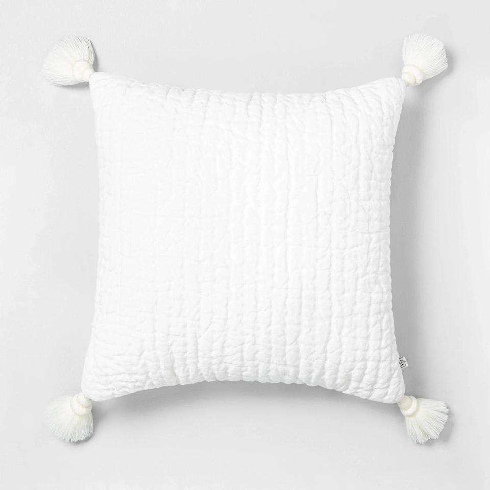 """<p>To mirror the tassels in the curtains, I got this <a href=""""https://www.popsugar.com/buy/Hearth-amp-Hand-Tassel-Pillow-553469?p_name=Hearth%20%26amp%3B%20Hand%20Tassel%20Pillow&retailer=target.com&pid=553469&price=20&evar1=casa%3Aus&evar9=47486578&evar98=https%3A%2F%2Fwww.popsugar.com%2Fphoto-gallery%2F47486578%2Fimage%2F47486774%2FHearth-Hand-Tassel-Pillow&list1=shopping%2Cfurniture%2Ceditors%20pick%2Capartments%2Chome%20decorating%2Csmall%20space%20living%2Capartment%20living%2Cdecor%20shopping%2Chome%20shopping%2Cat%20home%20with%20popsugar&prop13=api&pdata=1"""" class=""""link rapid-noclick-resp"""" rel=""""nofollow noopener"""" target=""""_blank"""" data-ylk=""""slk:Hearth &amp; Hand Tassel Pillow"""">Hearth &amp; Hand Tassel Pillow</a> ($20) for my sofa.</p>"""